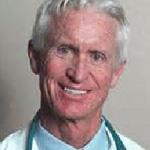 Close up of elderly man in lab coat